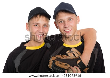 Young twin brothers holding each other isolated on white background - stock photo