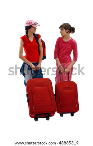 Young two teenager drag luggages - stock photo