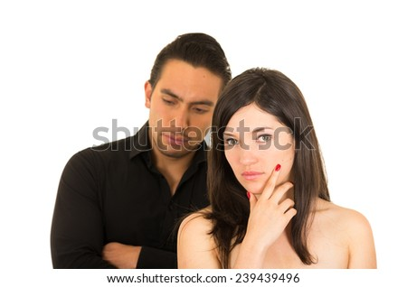 young unhappy couple ignoring each other after having an argument isolated on white - stock photo