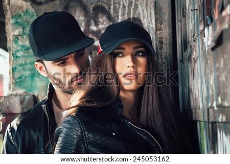 Young urban couple posing selective focus on woman - stock photo