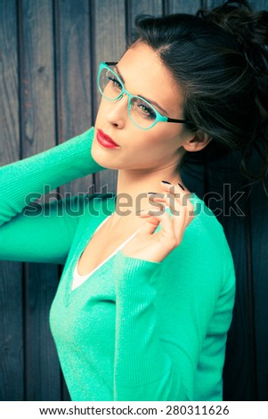 young urban fashion woman wearing eyeglasses outdoor shot in the city - stock photo