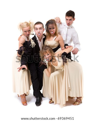Young vampires posing against isolated white background - stock photo