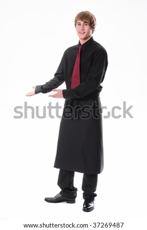 Young waiter invites to take place - stock photo