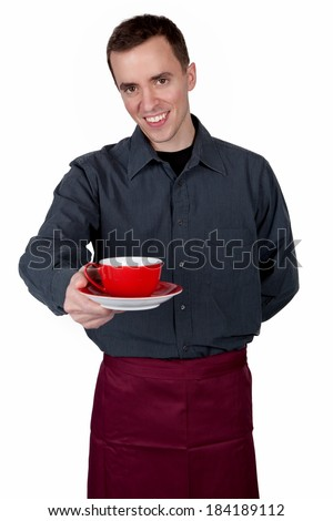 Young waiter with a cup in his hand  - stock photo