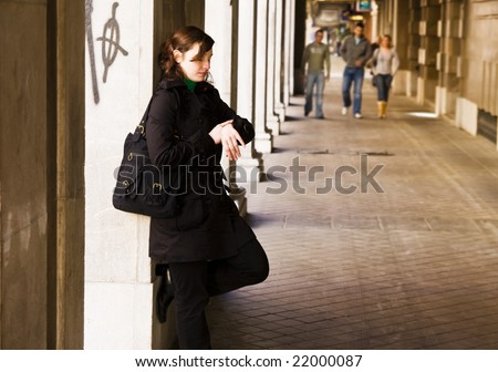 Young waiting woman checking time. - stock photo