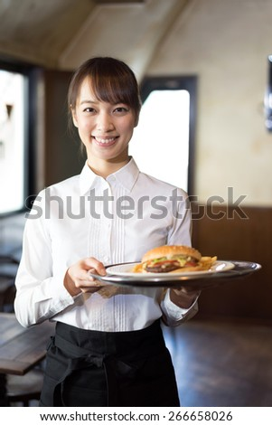 young waitress at cafe - stock photo