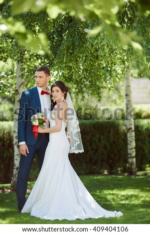 Young wedding couple, beautiful bride with groom in summer nature outdoor - stock photo