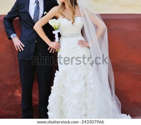 Young wedding couple having fun outside. - stock photo