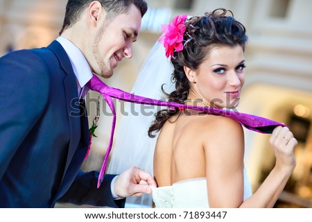 Young wedding couple indoors funny portrait. - stock photo
