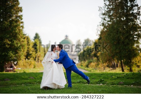 Young wedding couple on background old castle