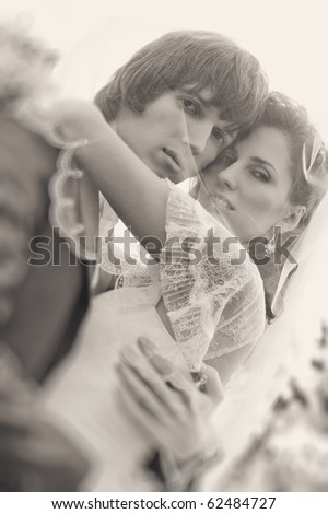 Young wedding couple portrait. Retro style colors. - stock photo
