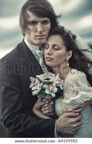 Young wedding couple tender portrait.