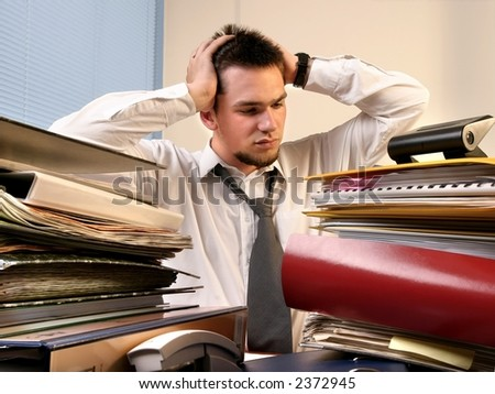 young, white callar worker on his job training  overloaded with work