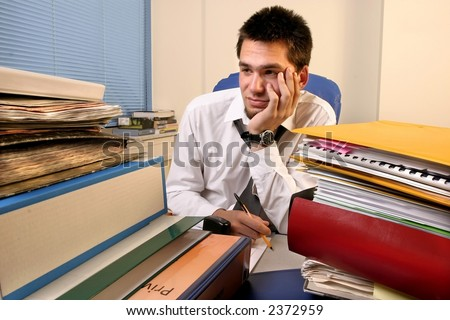 young, white callar worker on his job training  overloaded with work - stock photo