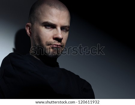 Young white guy looking angry close up