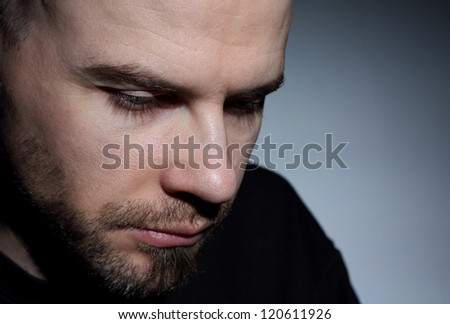 Young white guy looking depressed close up - stock photo