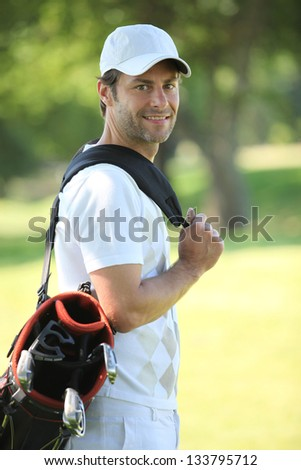 Young with golf bag - stock photo