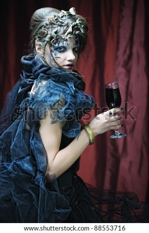 Young with with red wine - stock photo