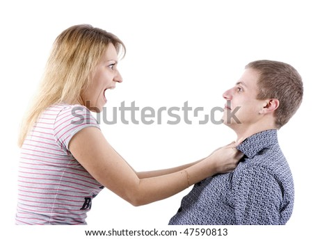 young woman abusing a man holding him by the shirt - stock photo