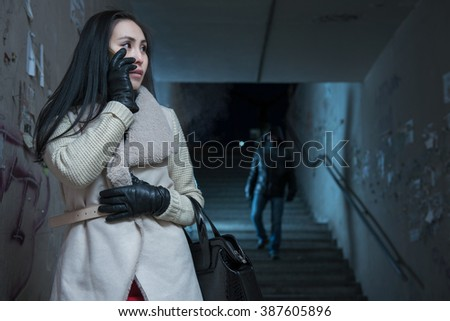 Young woman along at night at a danger