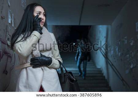 Young woman along at night at a danger - stock photo