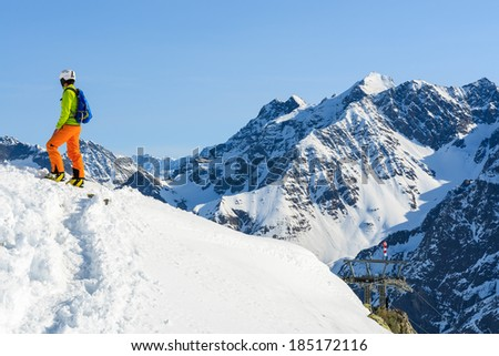 Young woman alpine skier on ascent to top of a mountain, Austrian Alps, Riffelsee Pitztal - stock photo