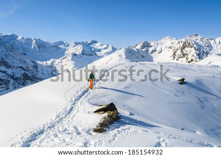 Young woman alpine skier on route in Austrian Alps, Riffelsee area near Pitztal glacier - stock photo