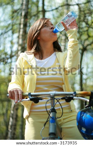 young woman and bike in the forest - break - stock photo