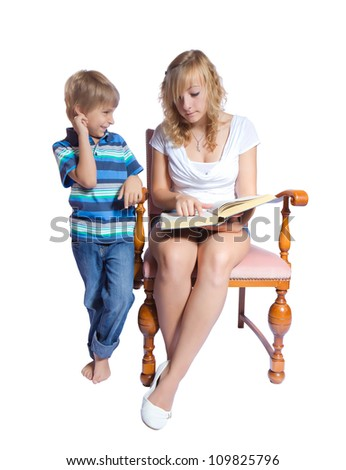 Young woman and boy reading a book. Isolate on white background - stock photo