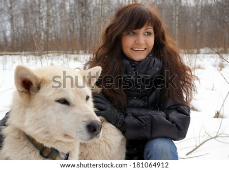 Young woman and dogs siberian husky on snow, winter   - stock photo