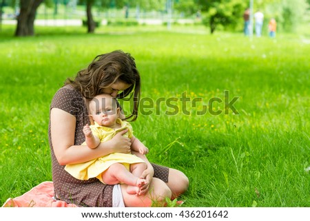 young woman and her cute baby girl outdoor