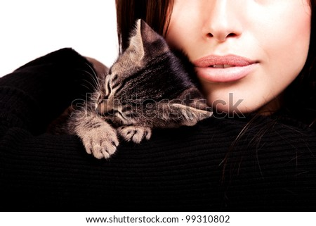 young woman and kitten close up portrait, studio