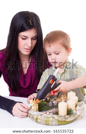 young woman and little boy with advent wreath - isolated