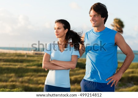Young Woman and Man Joggers Resting