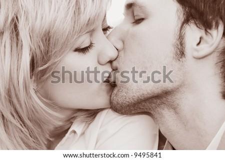 young woman and man kiss close-up