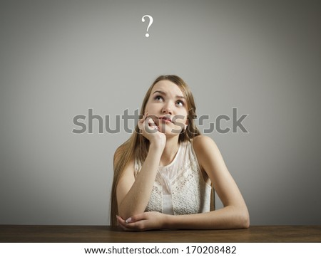 Young woman and question mark above head. - stock photo
