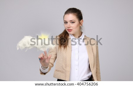 Young woman and sun shining out from behind the clouds, cloud computing  or weather concept - stock photo