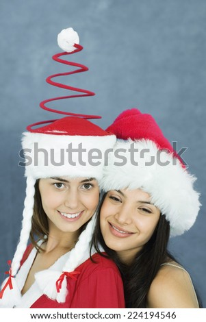 Young woman and teenage girl wearing holiday costumes, portrait - stock photo