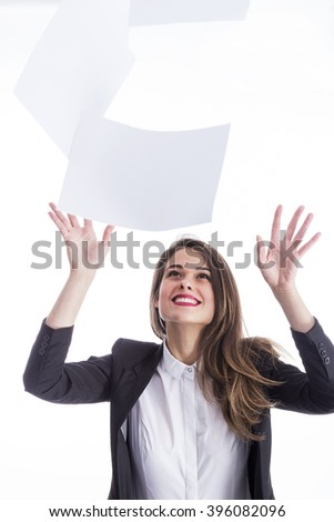 Young woman and throwing away papers - stock photo