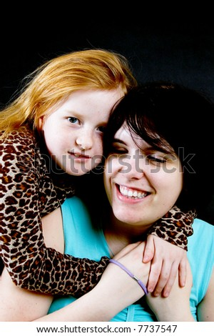 young woman and young little girl - stock photo