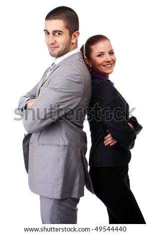 young woman and young man standing back to back - stock photo