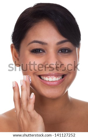 Young Woman Applying Cream On Her Face Over White Background - stock photo
