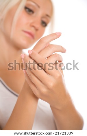 Young woman applying cream to hands Focus point on a hands