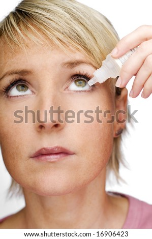 young woman applying eyedroppers close up shoot - stock photo