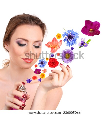 Young woman applying perfume with flower aroma, isolated on white - stock photo