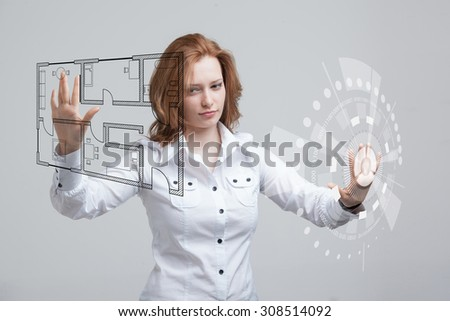 Young woman architect working with a virtual apartment plan - stock photo