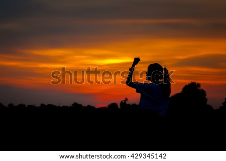 Young woman are happy in sunset silhouette.