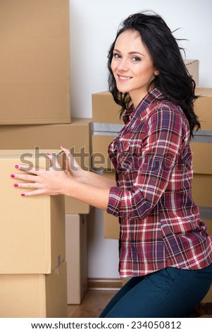 Young woman are moving into a new apartment. - stock photo
