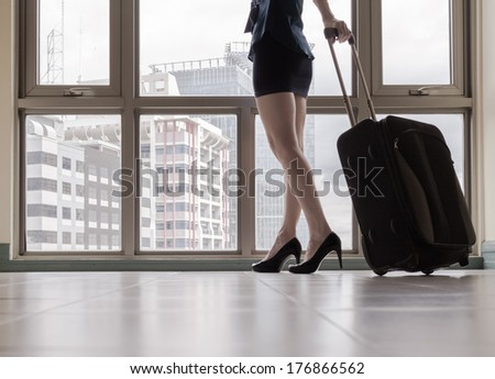 Young woman arriving in a new city. Travel,moving concept.