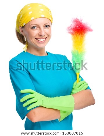 Young woman as a cleaning maid holding static duster, isolated over white - stock photo